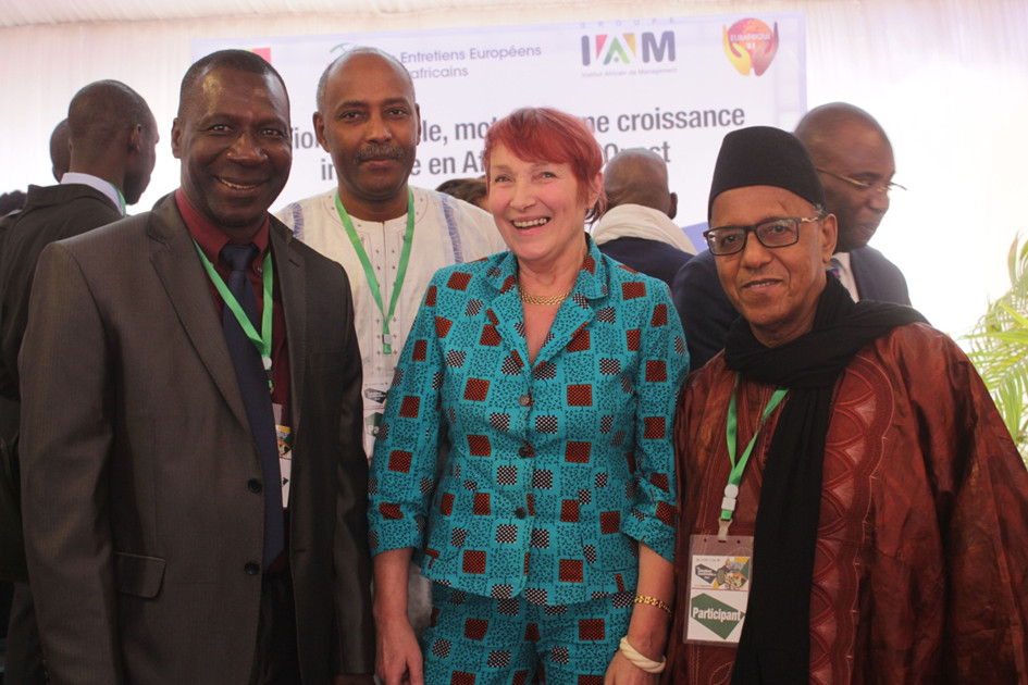 UNISEN Representatives and Ms Claude Fischer-Herzog. From left to right: Moussa Cissé, Secretary General, Victor Ousmane Sow, Treasurer, and Abibe Fall, President